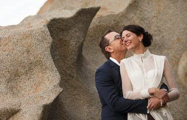 The Bride and groom sharing a kiss at the Remarkable Rocks in Kangaroo Island after their wedding