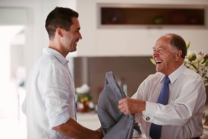 Grandfather greets the groom on the morning of the wedding