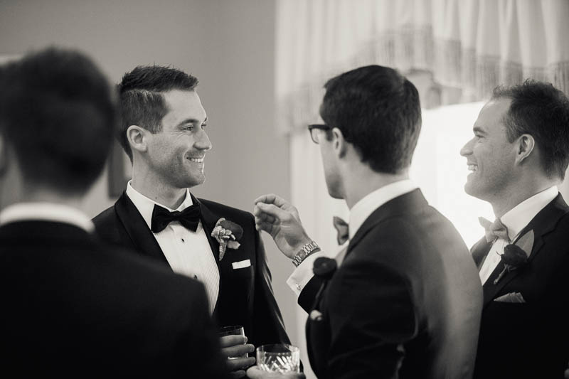 Groomsmen share a scotch while waiting for the wedding to start at Mandalay House and Garden