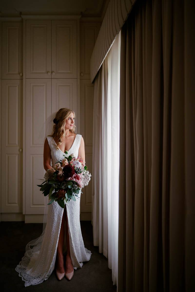 Portrait of the bride looking out the window at Mandalay House and Garden