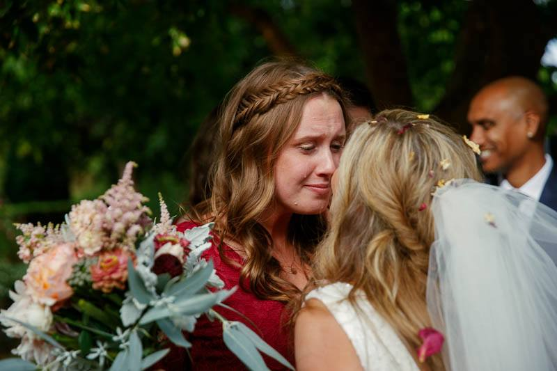 Bridesmaid with happy tears during congratulations after the wedding ceremony at Mandalay House and Garden