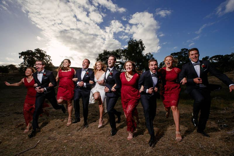 The bridal party skipping, looking super happy