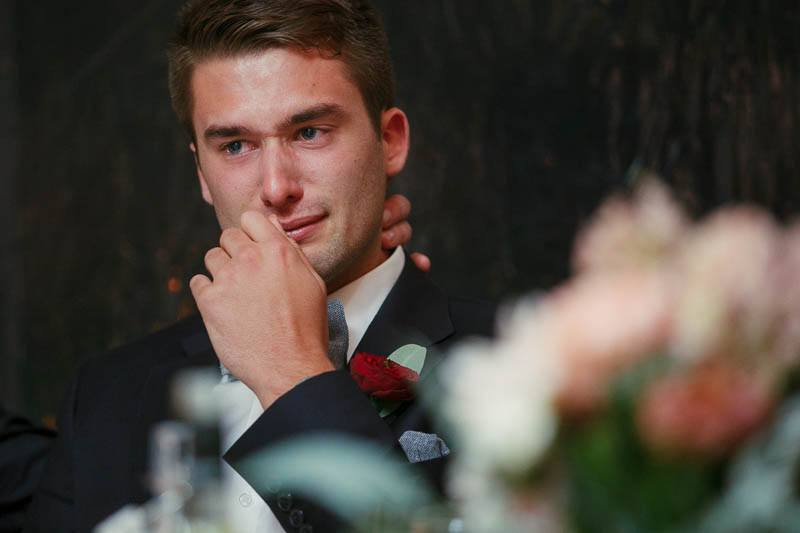 Brother of the groom getting teary at the best man speech