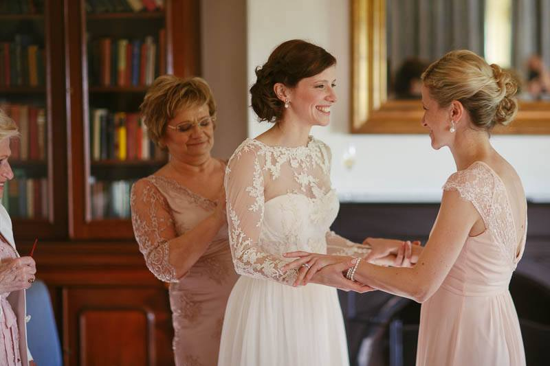 Lovely moments between the girls after the bride is fully dressed