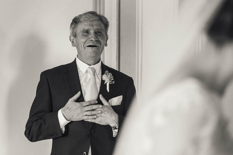 Father seeing his daughter for the first time in her wedding dress