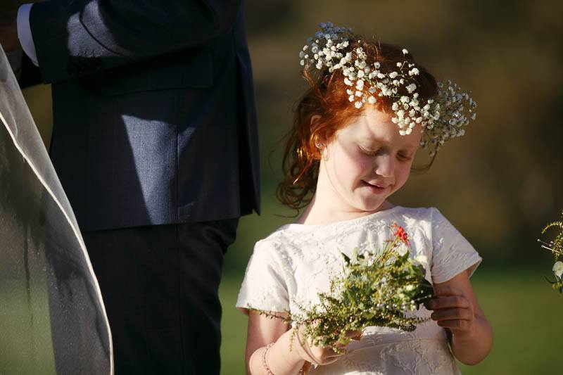 Flower girl distracted during the wedding ceremony