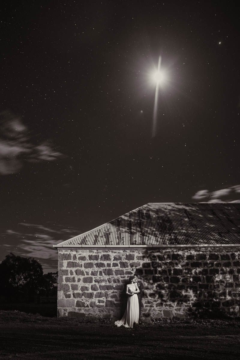 Outside at night against an old stone building, stars in the sky at Mt Sturgeon and Royal Mail Hotel