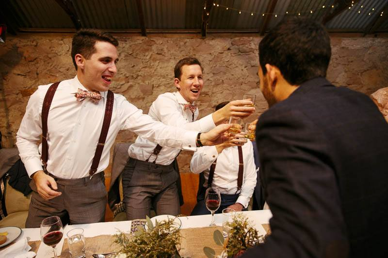 Guests cheers with the groomsmen