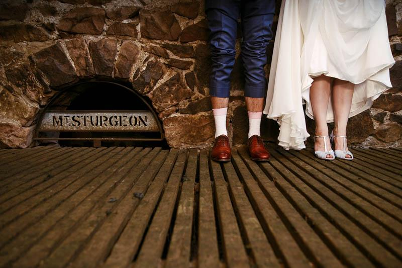 Bride and groom share a quiet moment in the shearing sheds at night at Mt Sturgeon Homestead