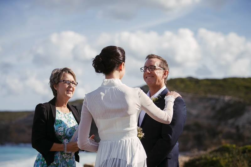 The couple having some fun during the wedding ceremony at Southern Ocean Lodge