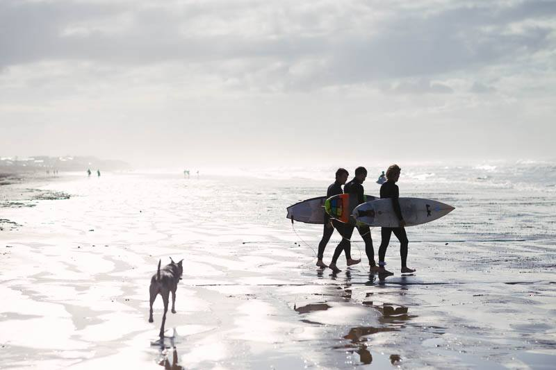 The boys off for an early morning surf on the day of the wedding