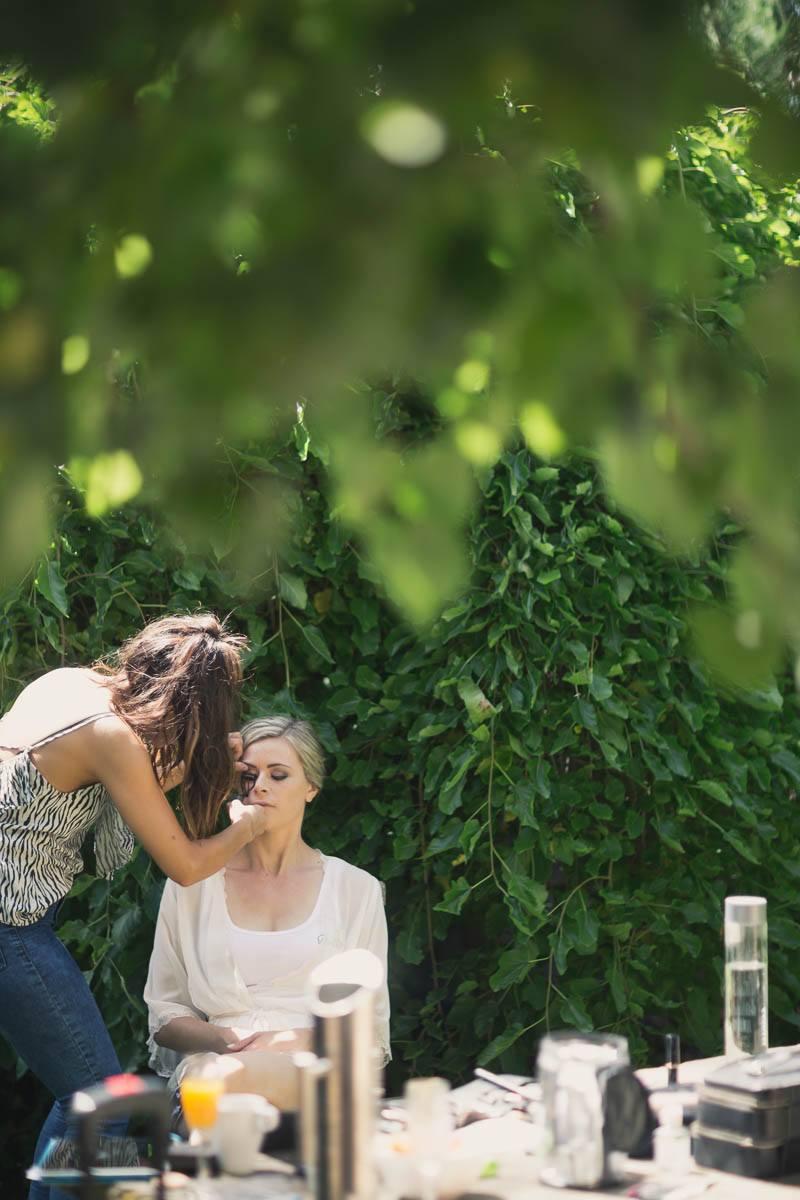 The bride having her makeup done outside at Waverley Estate