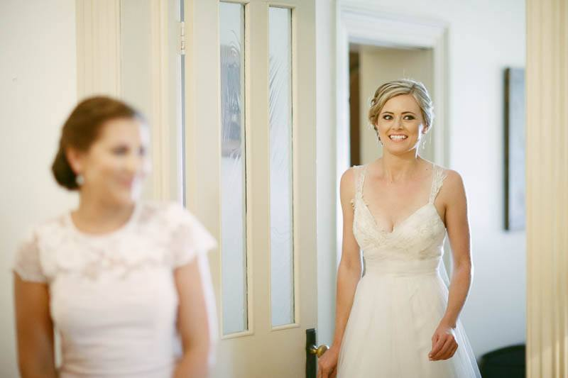 The bride coming out to be seen by her parents for the first time