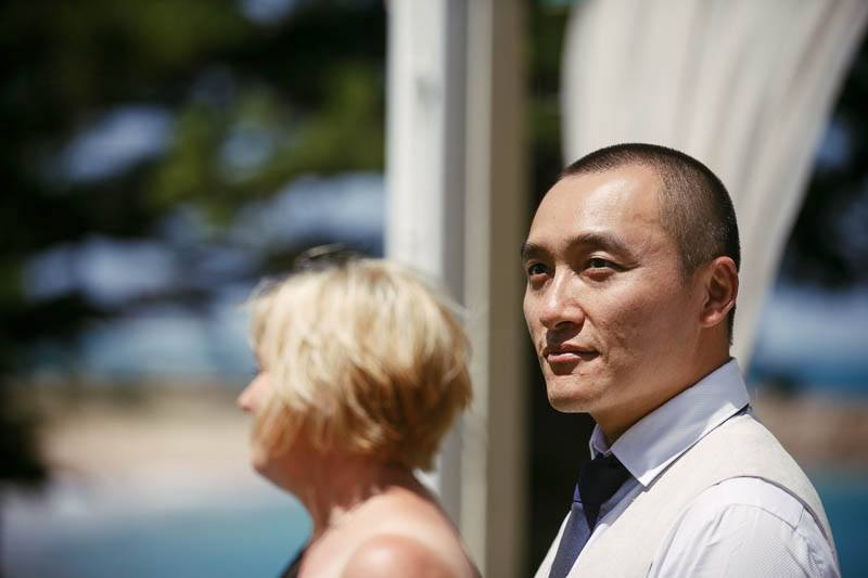 Groom waiting for his bride at the begining of the wedding ceremony