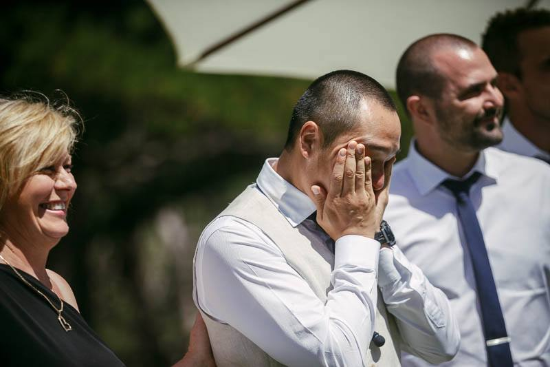 Groom crying while the bride enters