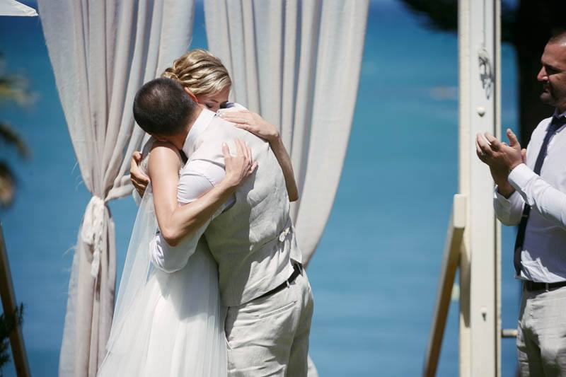 Groom and bride hugging after the end of the ceremony