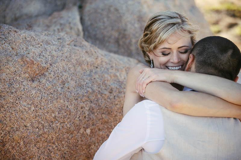 Bride and groom on the cliffs at Port Elliott sharing a tender moment