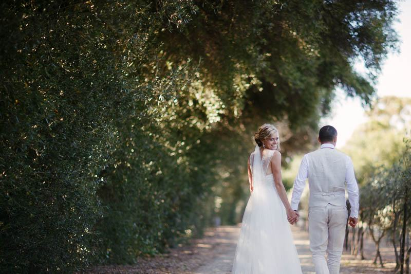 Bride and groom walking up the driveway at Waverley Estate, wedding photography by James Field