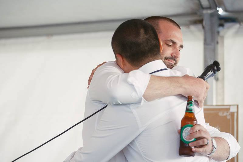 Best man hugging the groom after his speech at the wedding reception at Waverley Estate