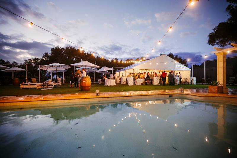 Exterior shot after sunset of the reception at Waverley Estate