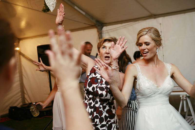 Bride and guests dancing at the wedding reception