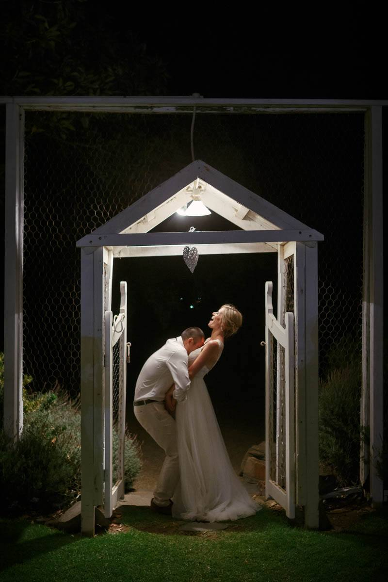 Silly night time portrait of bride and groom outside