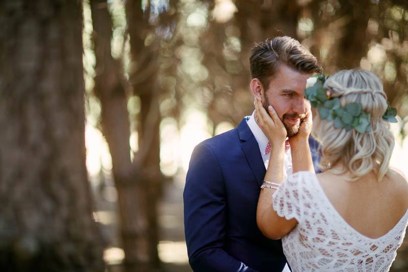 the bride and groom sharing an intimate moment in the pine forest at Barristers Block