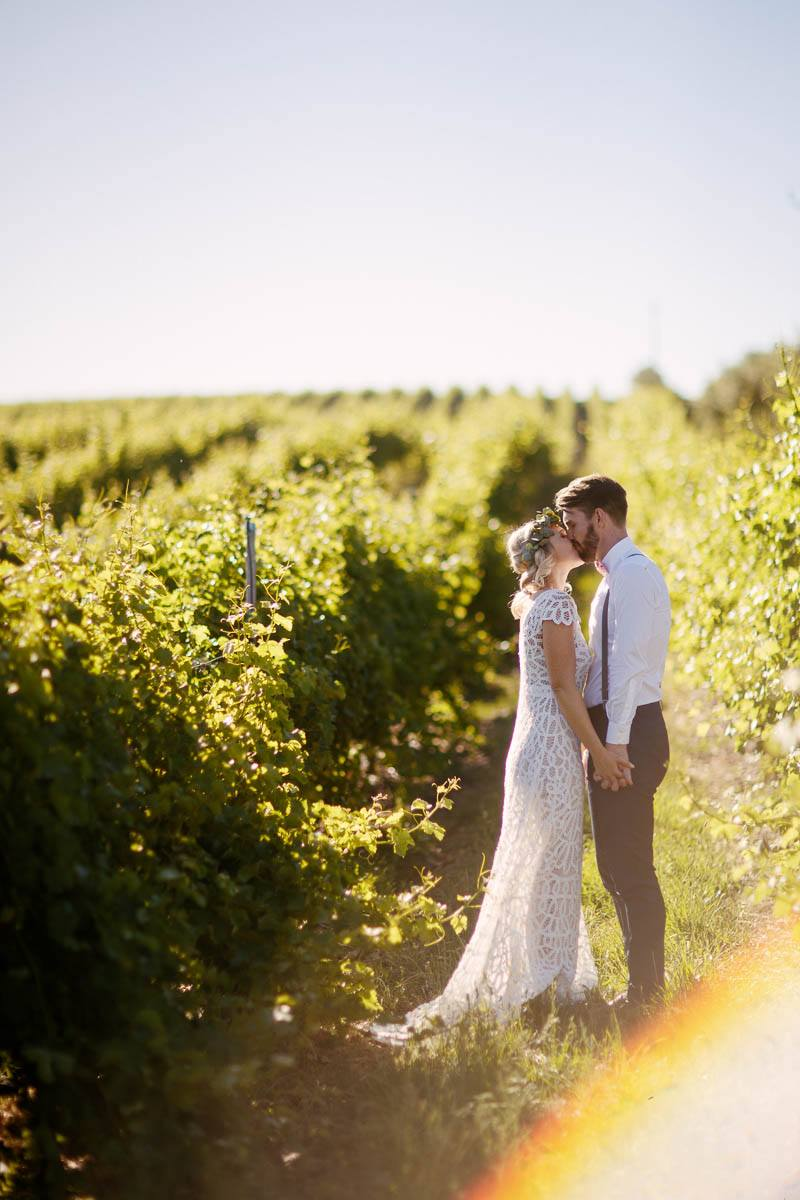 The newlyweds hanging out in the vineyards after the wedding at Barristers Block