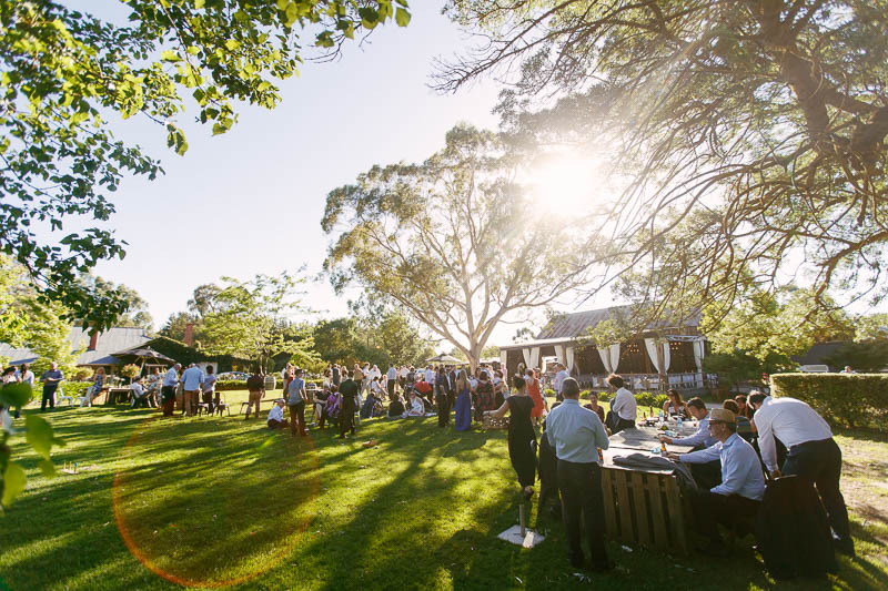 Guests enjoying pre dinner drinks on the lawns just before sunset at Barristers Block