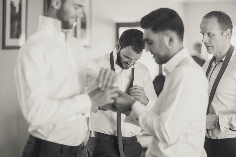 Groomsmen getting dressed for the wedding