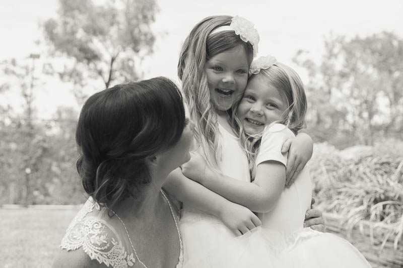 Bride and flower girls having fun together