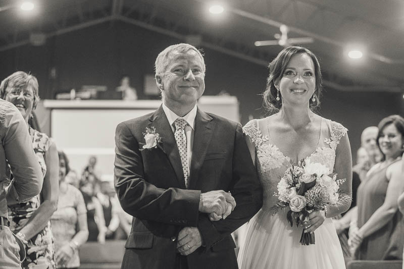 Father and the bride walking down the aisle at Oakden Baptist church