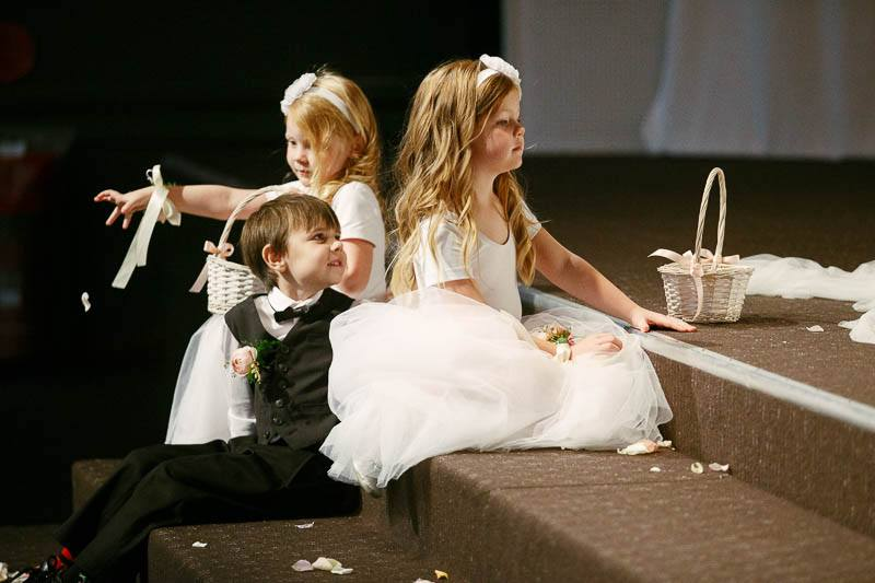 Flower girls and page boys playing at the front of the ceremony