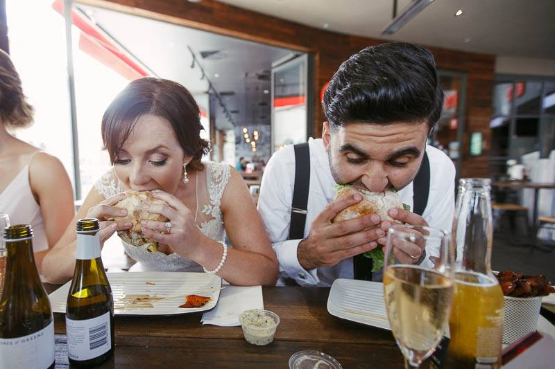 Bride and Groom eating burgers from Grill'd