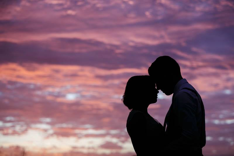 Silhouette of the bride and groom during a beautiful sunset at Clean Slate