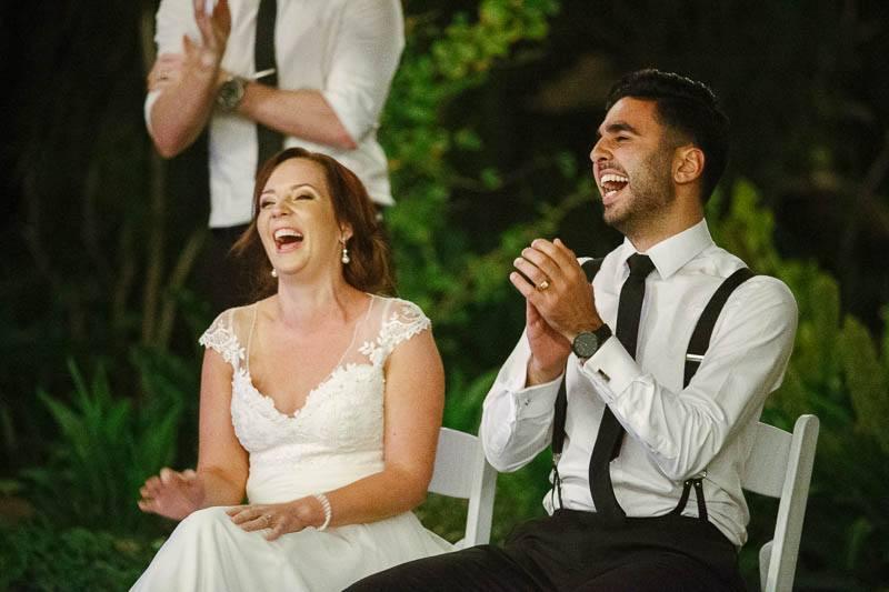 The bride and groom enjoying the best man speech
