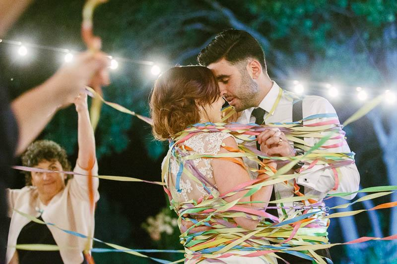 First dance for the bride and groom, covered in streamers at Clean Slate