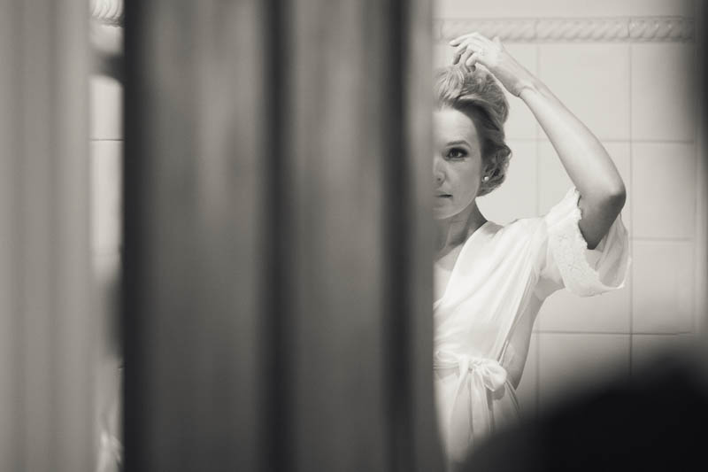 Bride looking at her hair in the mirror