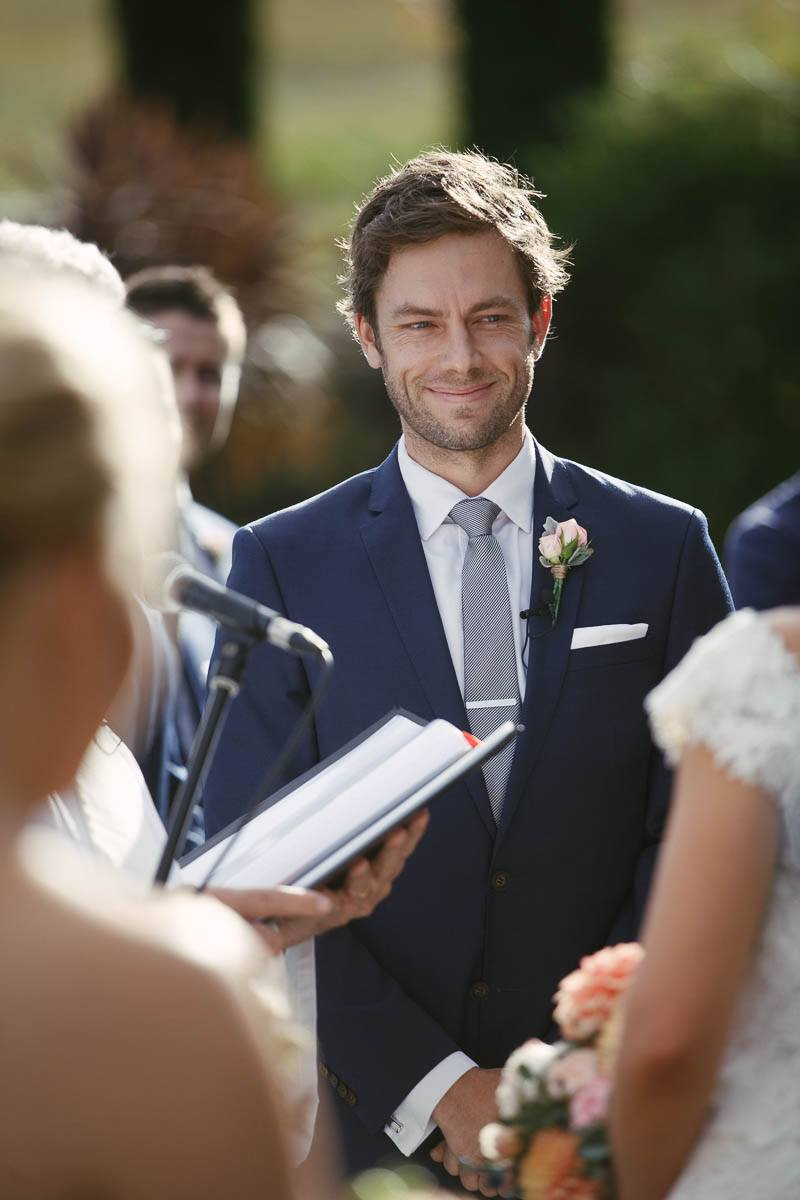 Groom smiling at the bride during the ceremony