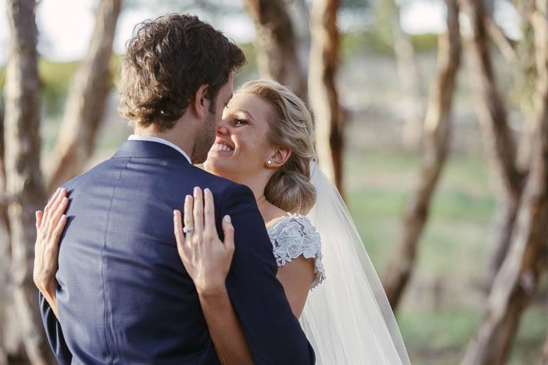 Bride and groom sharing an intimate moment in the gumtrees at Golding wines