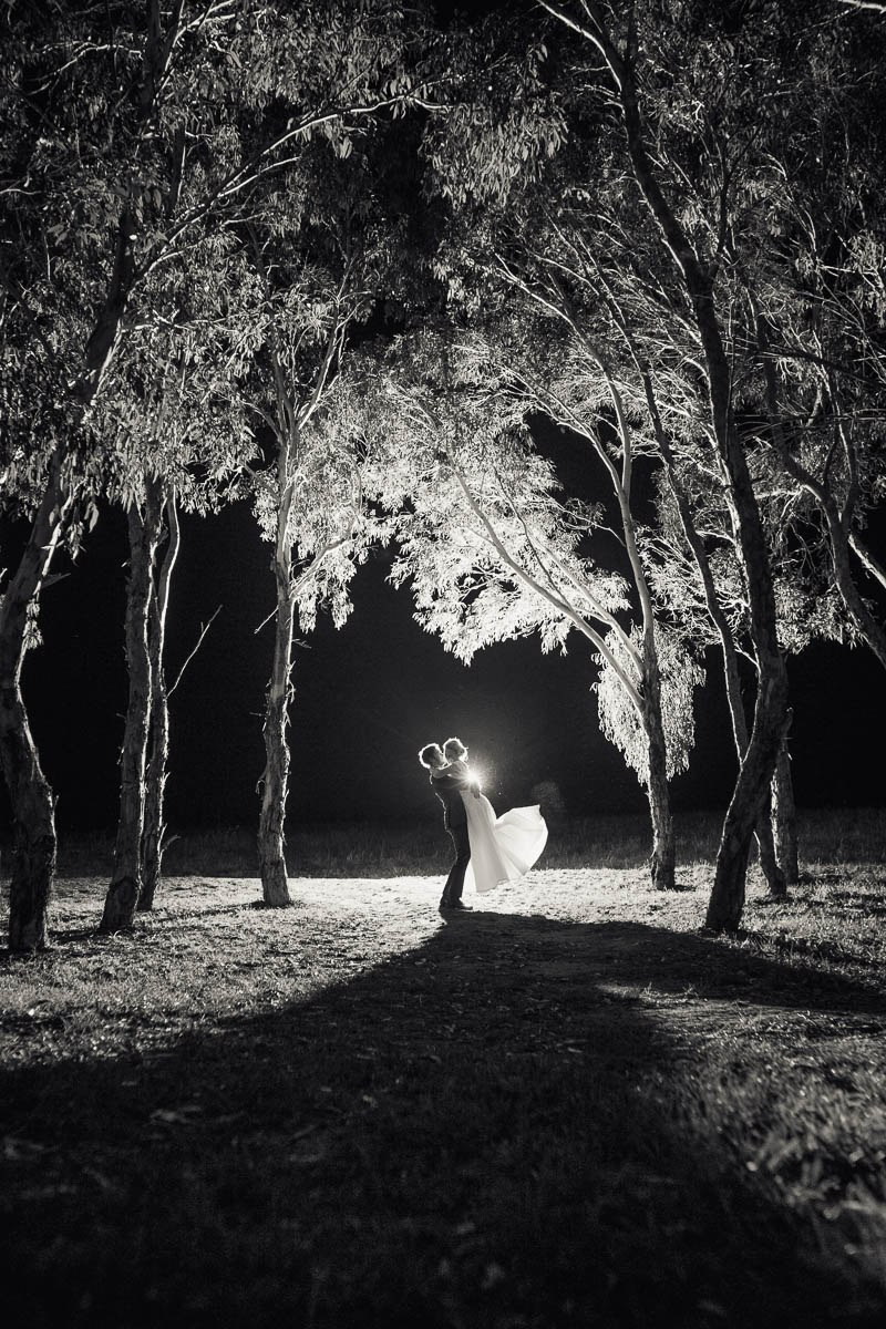 Bride and Groom night time photos outside backlit in some gumtrees