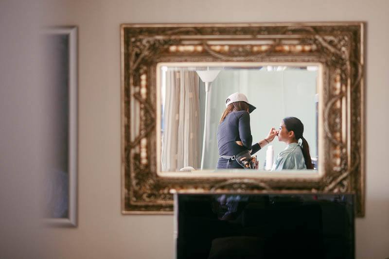 Makeup preparation for one of the bridesmaids