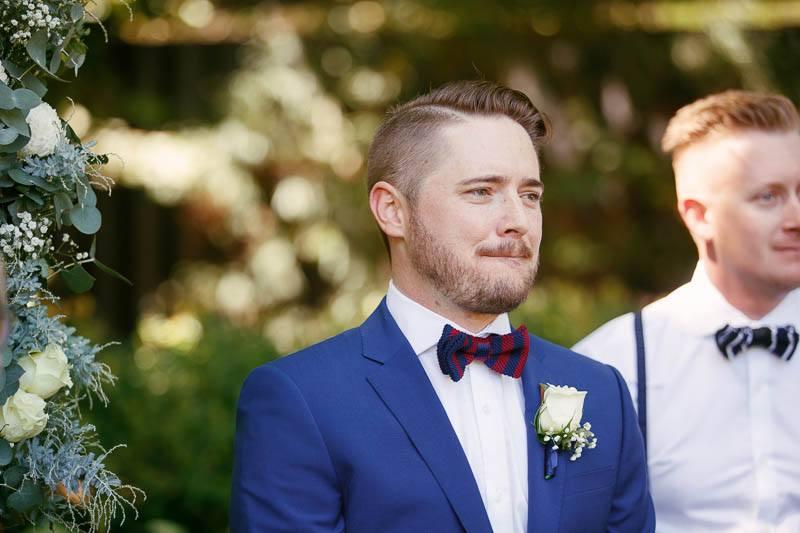 Groom watching his bride walk down the aisle at Inglewood Inn