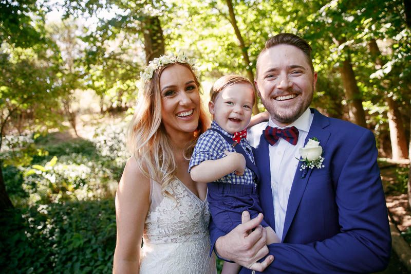 Newlyweds and their son pose for photos at Inglewood Inn