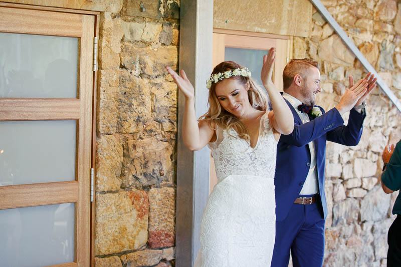 Entrance of the bride and groom to the song of their favourite footy team