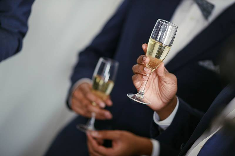 Sharing a glass of bubbles on the wedding morning