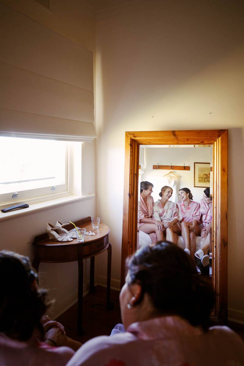 Bridesmaids chatting in the mirror in the Homestead at Longview