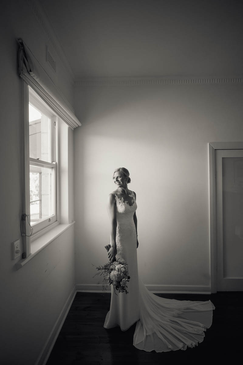 Bride looking out the window in the homestead at Longview