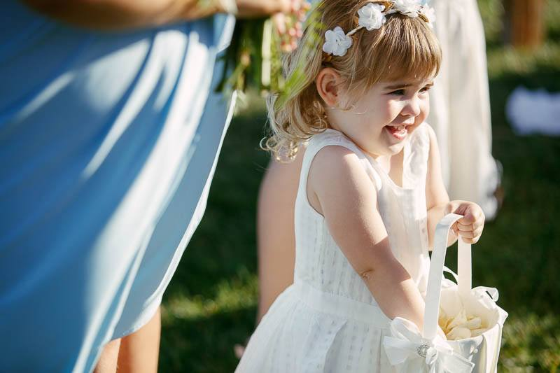 Flower girl excited just before the ceremony starts at Longview Vineyard
