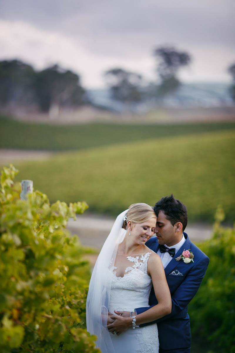 The couple share a moment in the vines at Longview Vineyard